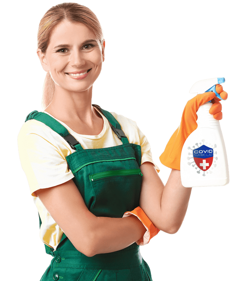 Housewife holding spray bottle of COVID Shield Disinfectant